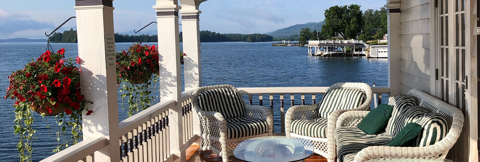 Boathouse waterfront sitting area on front porch