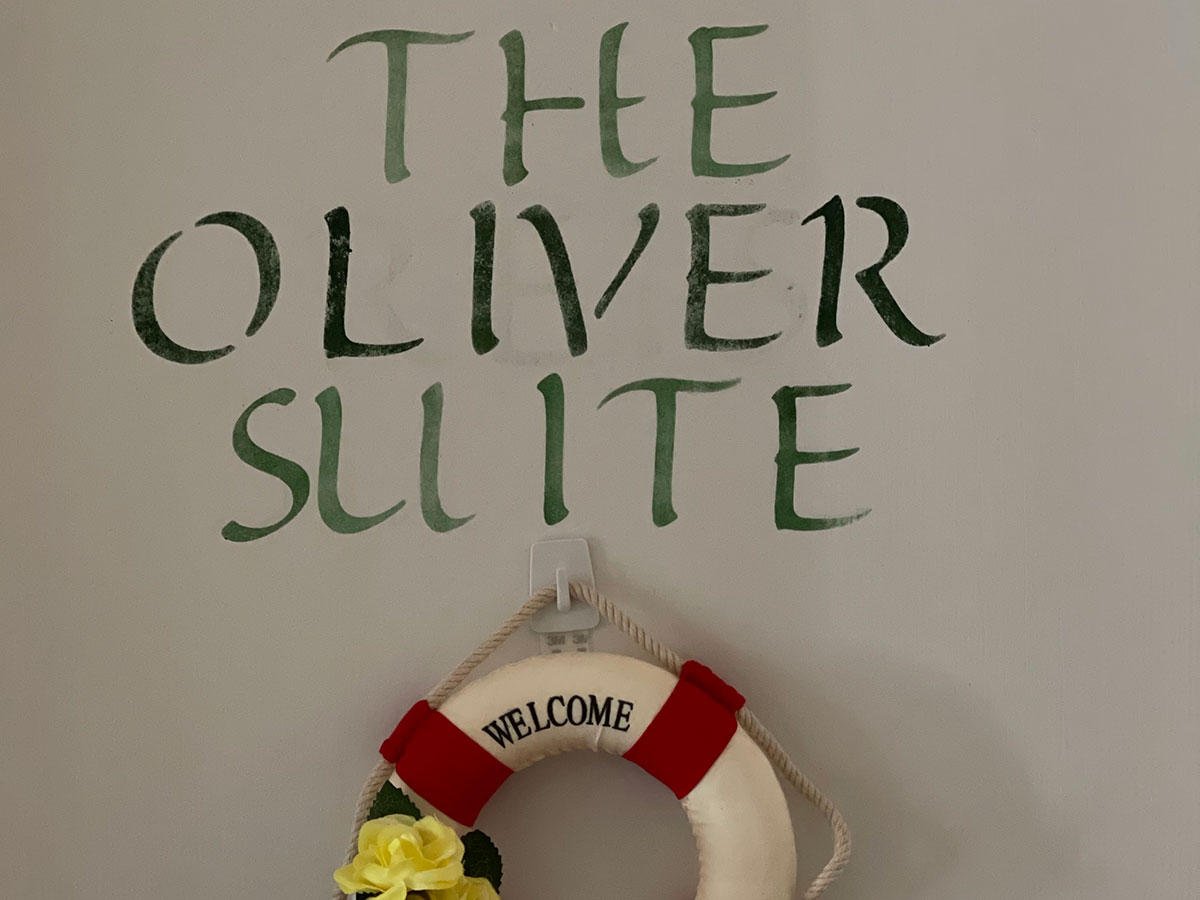 The Oliver Suite room sign
