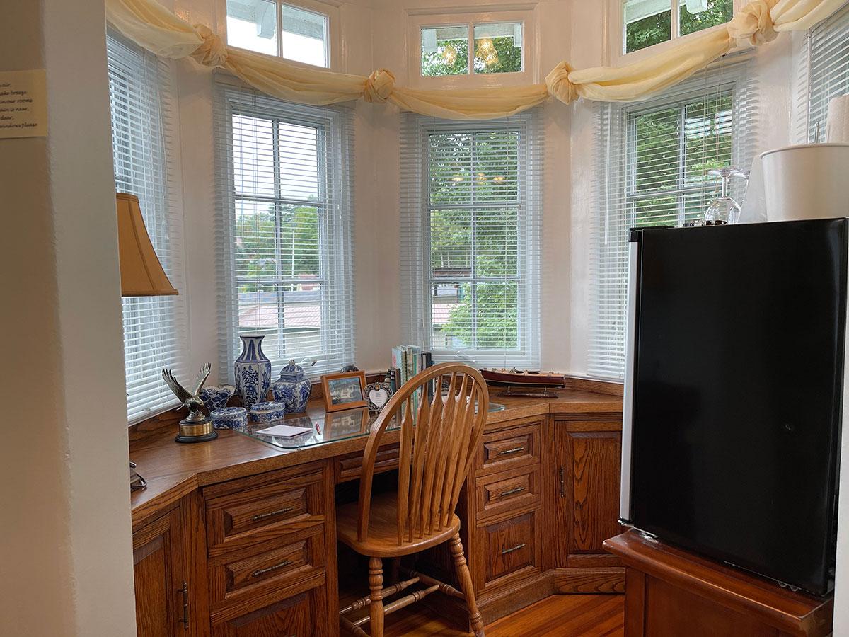 Tanner Room oak desk with views of Lake George