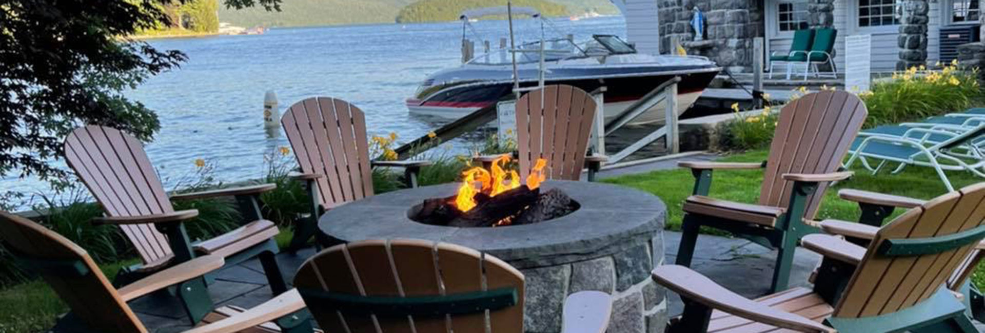Fire pit lakeside at Boathouse Waterfront Lodging